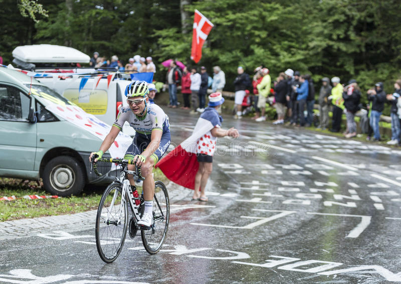 The Cyclist Christian Meier. Le Markstein, France- July 13, 2014:The Canadian cyclist Christian Meier of Orica-GreenEDGE Team , climbing the road to mountain royalty free stock images