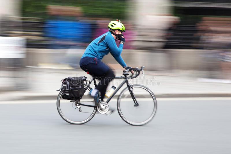 Cyclist in the city in motion blur royalty free stock photo