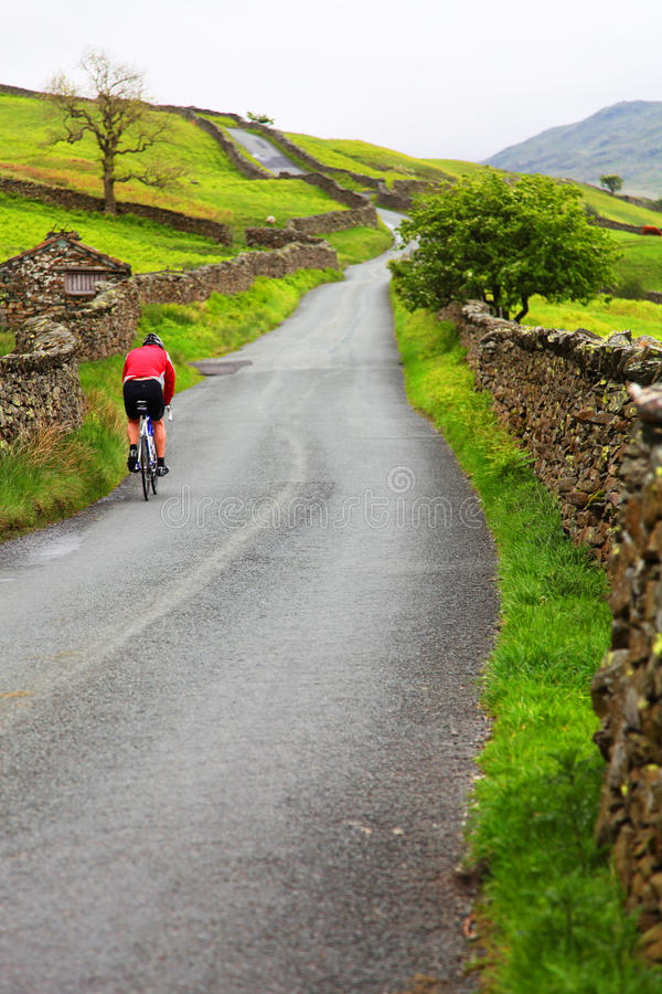 Cyclist in countryside stock images