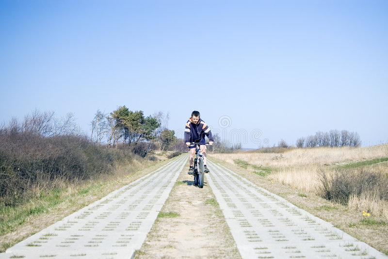 Cyclist on countryside track royalty free stock photo