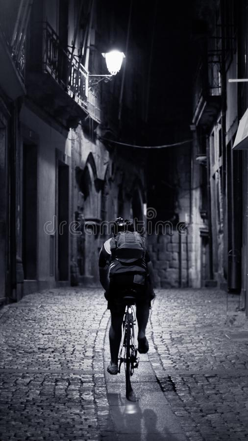 Old alley cyclist royalty free stock photos
