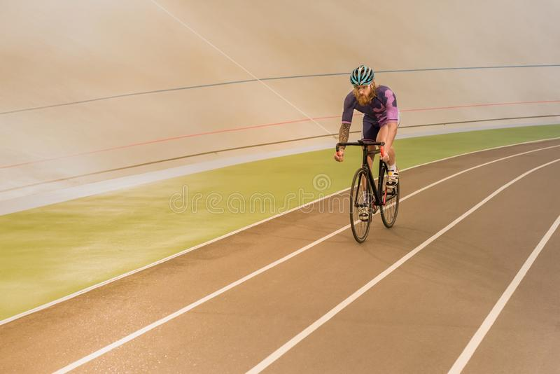 Cyclist on cycle race track. Young cyclist in helmet training on cycle race track stock photos