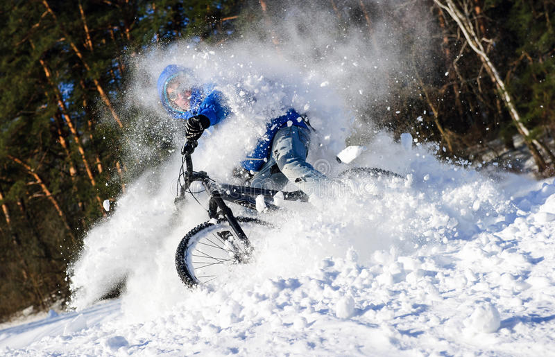 Cyclist extreme snow royalty free stock image