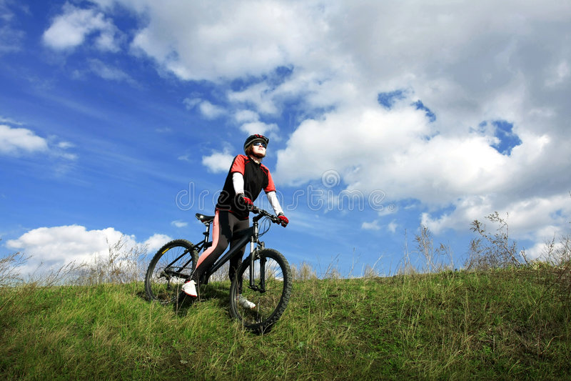 Cyclist going down the slope stock photos