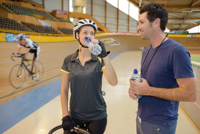 Cyclist having drink water stock images