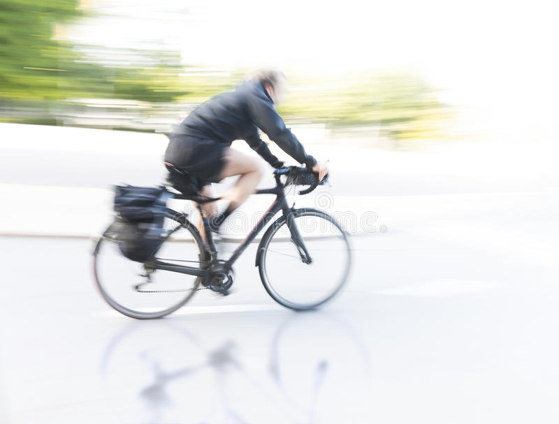 Cyclist at high speed royalty free stock image