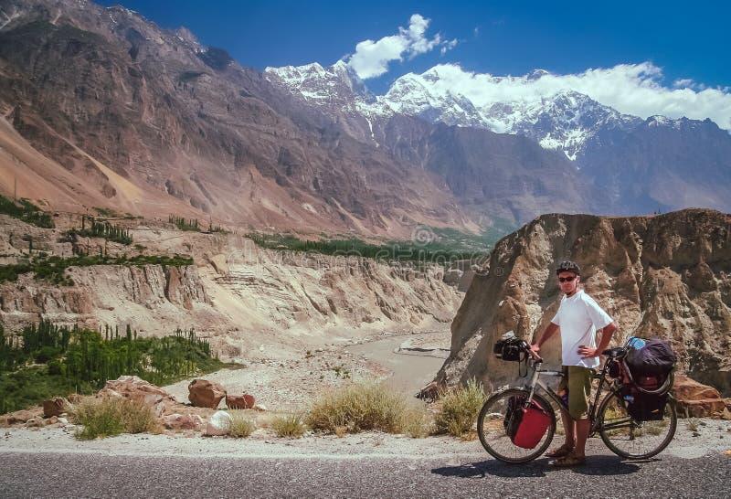 Cyclist on Karakorum Highway royalty free stock image