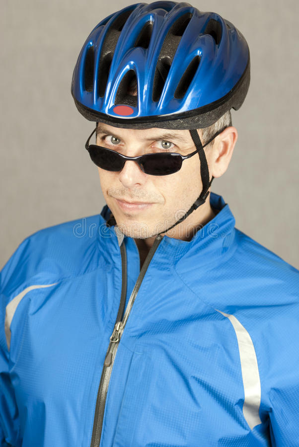 Cyclist Looks To Camera Stock Photography