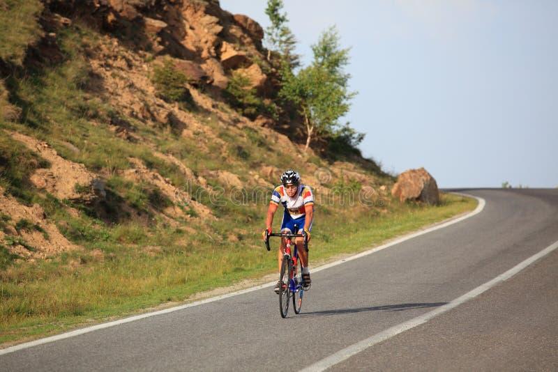 Cyclist from Moldovia riding downhill at Paltinis, Romania stock photo