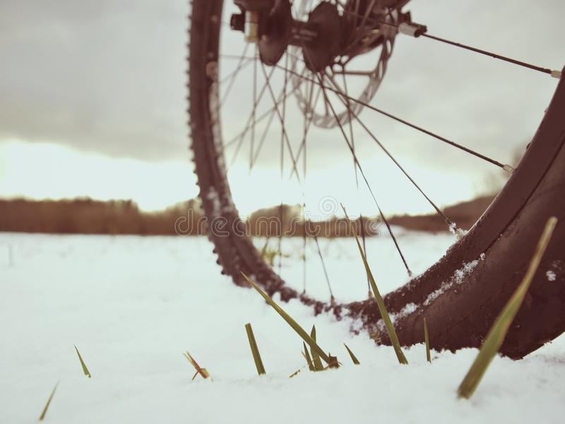 Cyclist on Mountain Bike on the Snowy Hill. Landscape Covered with Fresh Snow. Extreme Sports and Enduro Biking Concept stock photo