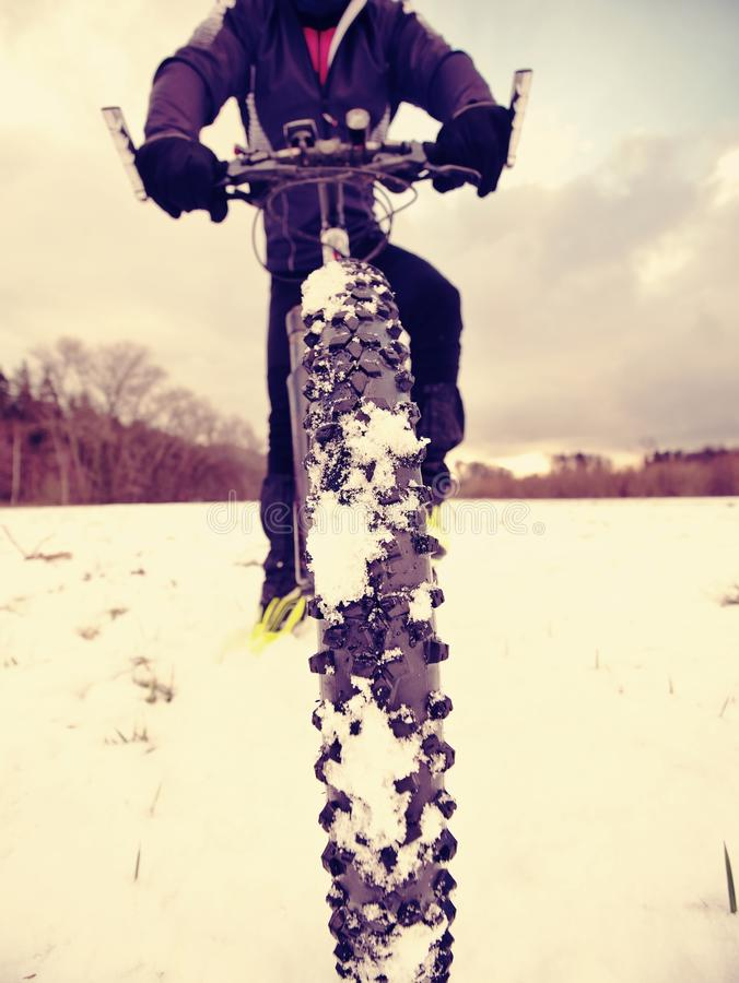 Cyclist on Mountain Bike on the Snowy Hill. Landscape Covered with Fresh Snow. Extreme Sports and Enduro Biking Concept stock image