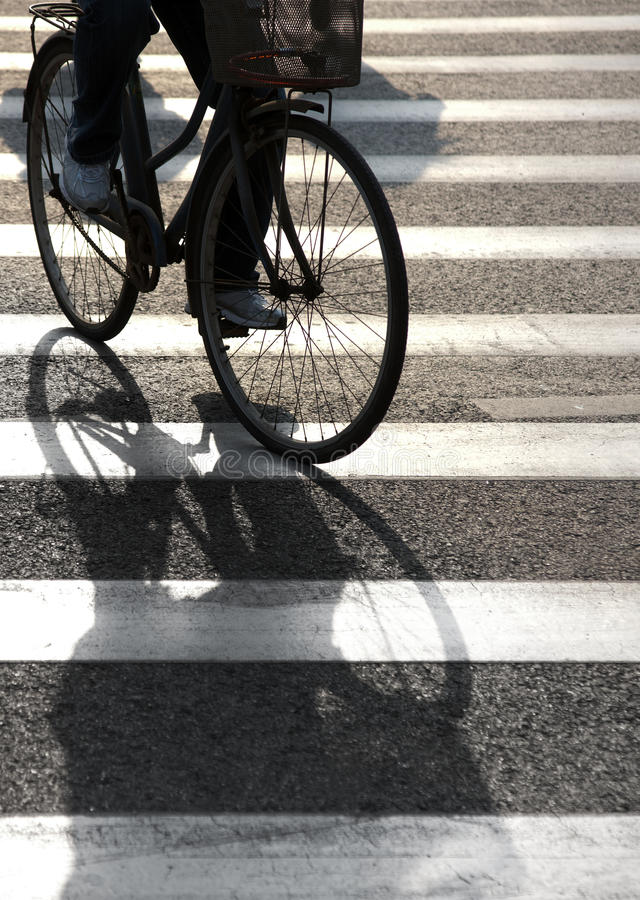 Cyclist on pedestrian crossing royalty free stock image