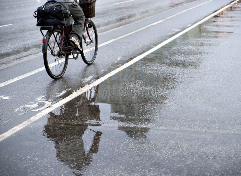Cyclist in rain stock photo