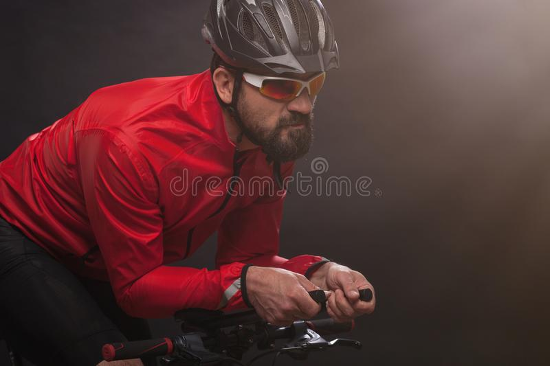 Cyclist in red jacket riding the bike. Extreme sport concept. royalty free stock images