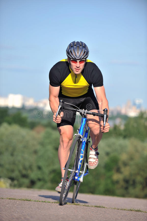 Cyclist riding a bicycle royalty free stock photo