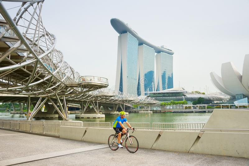 Cyclist riding bicycle, Singapore royalty free stock photography