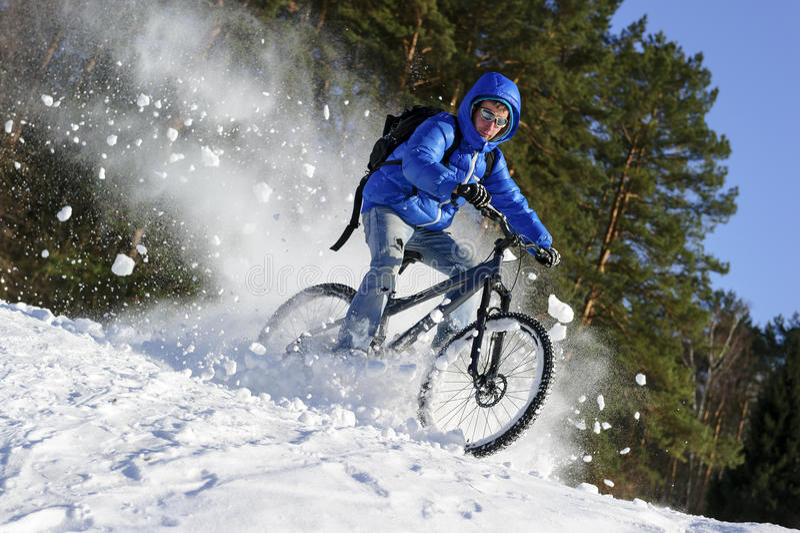 Cyclist riding bike royalty free stock photo