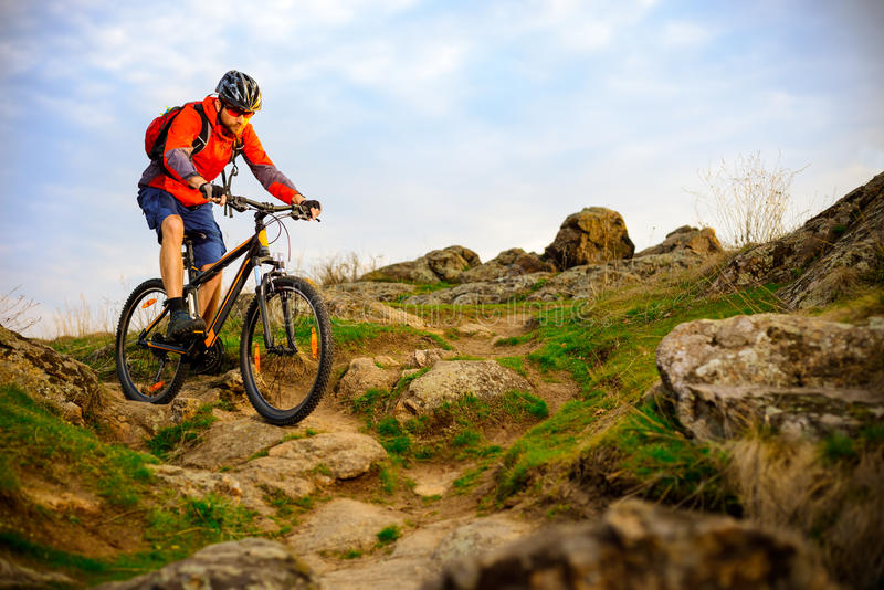 Cyclist Riding Mountain Bike on the Beautiful Spring Rocky Trail. Extreme Sport Concept. Cyclist Riding the Mountain Bike on the Beautiful Spring Rocky Trail stock photography