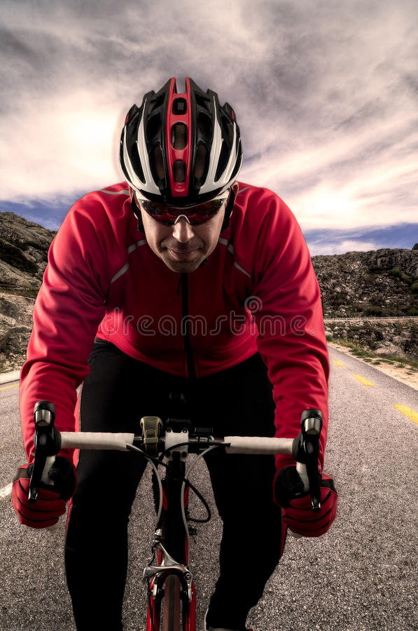 Cyclist on the road stock images