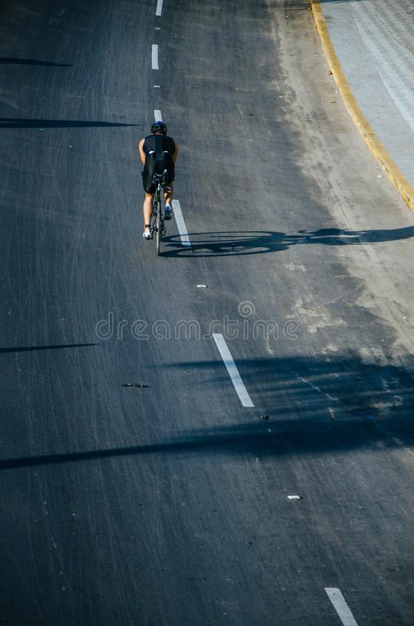 Cyclist on the road at full speed royalty free stock images
