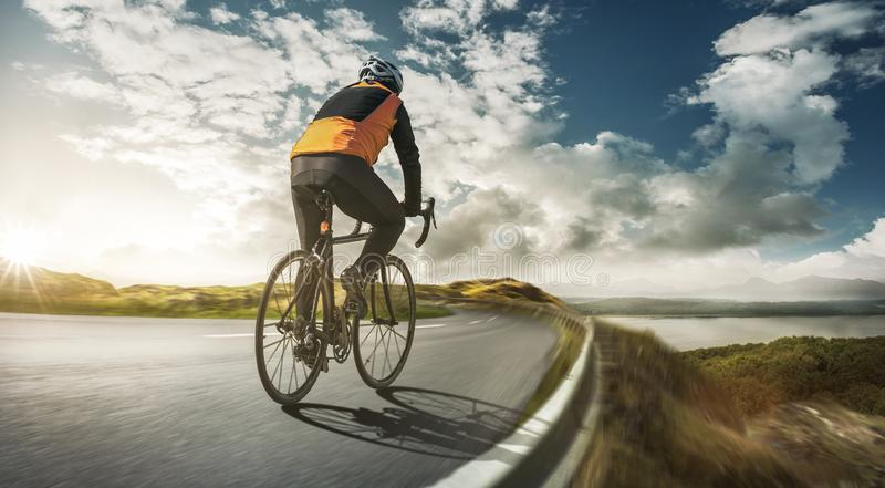 Cyclist on a road at full speed stock image