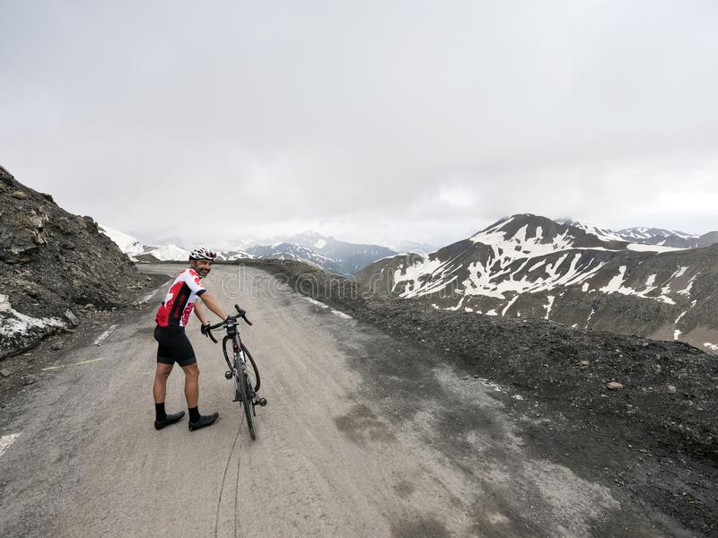 Download Cyclist Stands Next To His Bicycle On Top Of Mountain Pass Col De La Bonette In The French Alps Editorial Stock Image - Image of mountain, alpine: 120169619