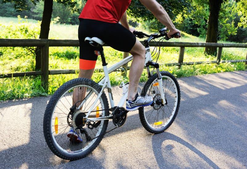 Cyclist starts riding a bike royalty free stock photos