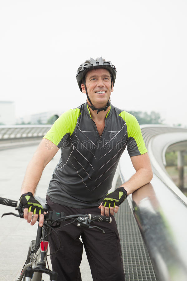 Cyclist. Vertical image of a professional cyclist resting and posing at camera stock photo