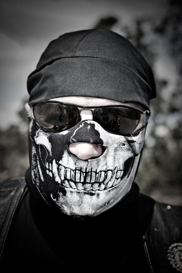 Cycliste avec le masque photo stock