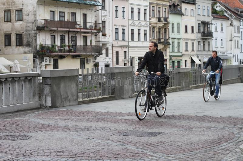 Cyclists in the centre of Ljubljana on their way to work. stock image