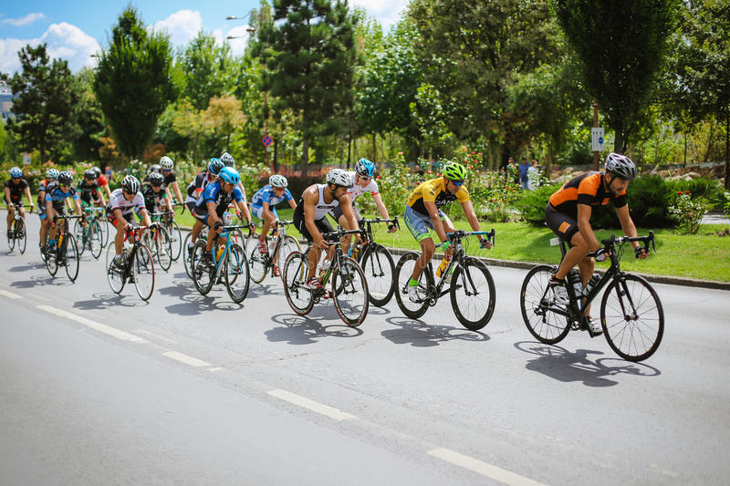 Cyclists competing. Happy cyclists competing in RGT Road Grand Tour Champions Race, Bucharest, Romania stock images