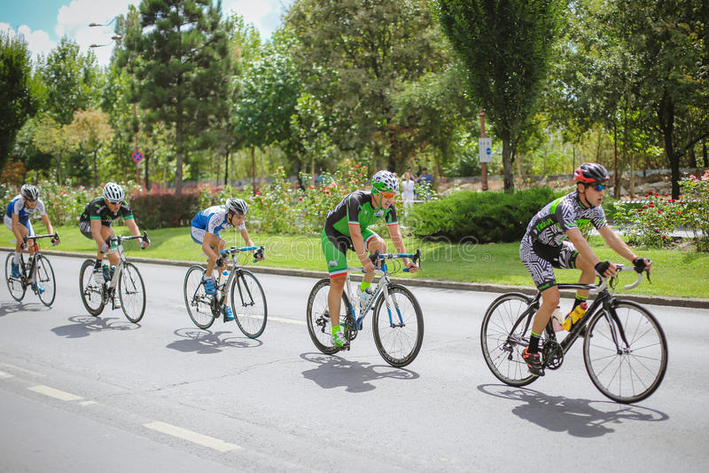 Cyclists competing. Happy cyclists competing in RGT Road Grand Tour Champions Race, Bucharest, Romania royalty free stock images