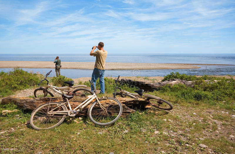 Download Cyclists On A Deserted Coast Stock Image - Image: 19040817