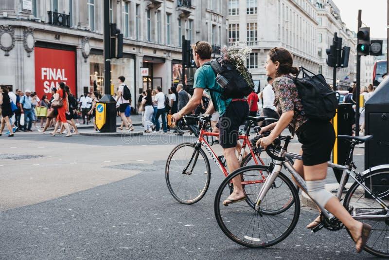 Cyclists on Oxford Street, London, UK. stock photos