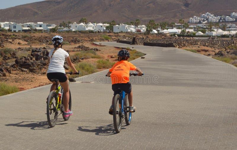 Cyclists Playa Blanca stock photos