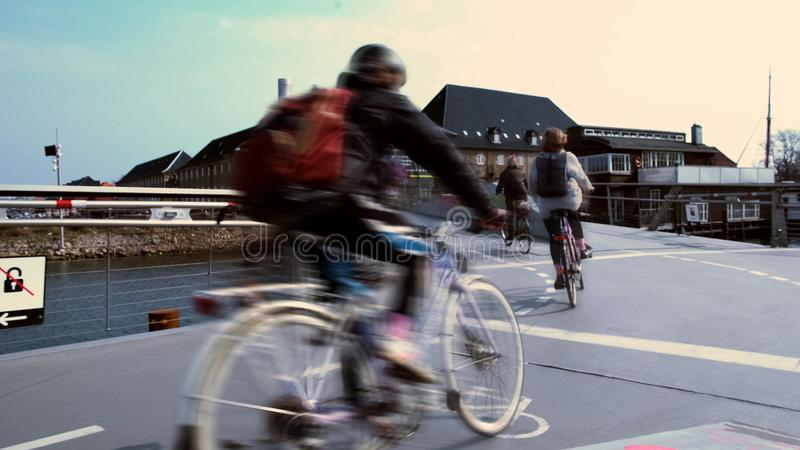 Cyclists quickly riding Copenhagen street, road rules and safety, law and order stock photos