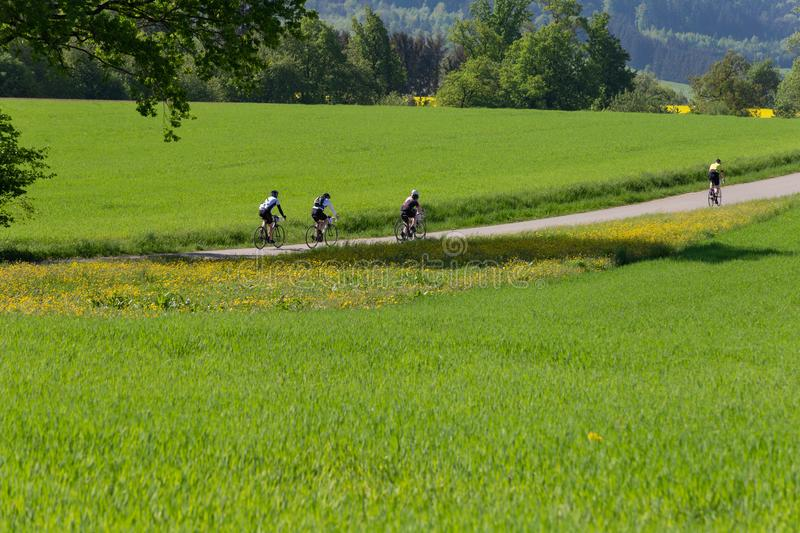 cyclists on a raceday in a distance view royalty free stock photos