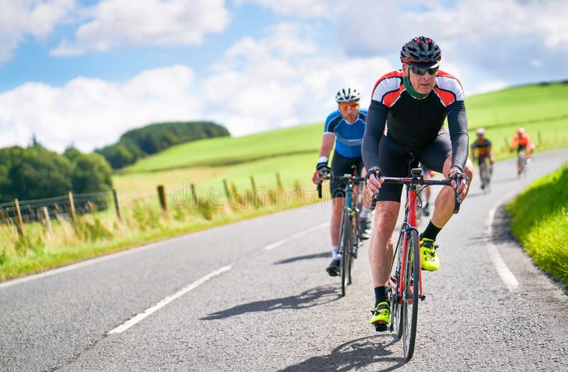Cyclists racing on country roads stock image