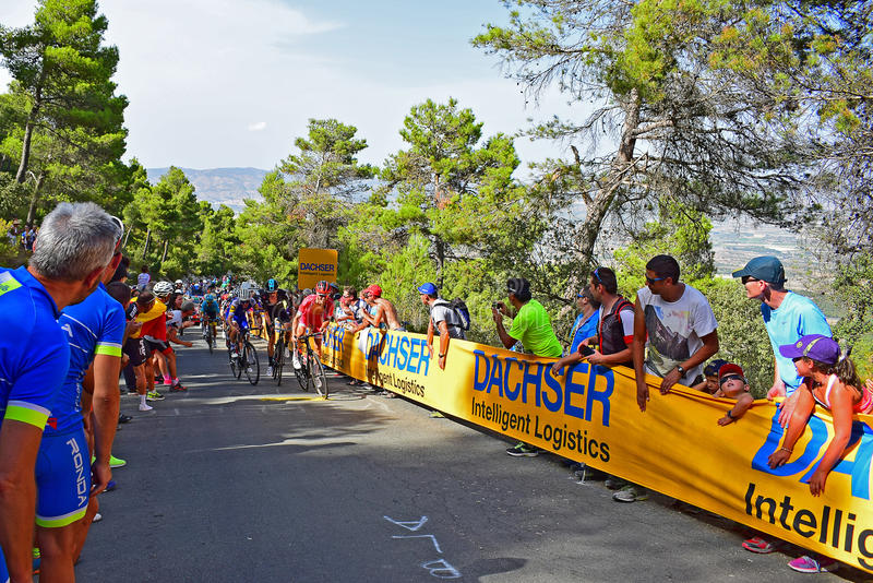 Cyclists Racing Up A Hill La Vuelta España Cycle Race. A group of riders near the mountain top finish in the 2017 La Vuelta Espana bike race royalty free stock photos