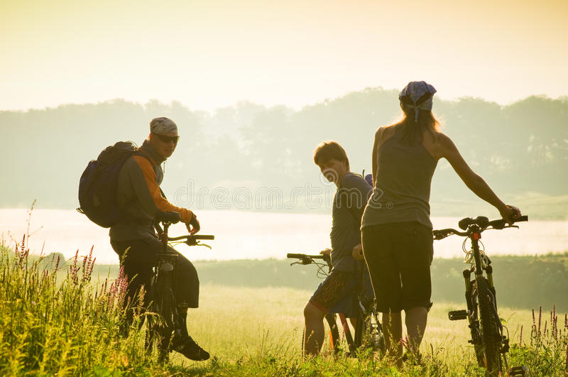 Cyclists relax biking outdoors stock images