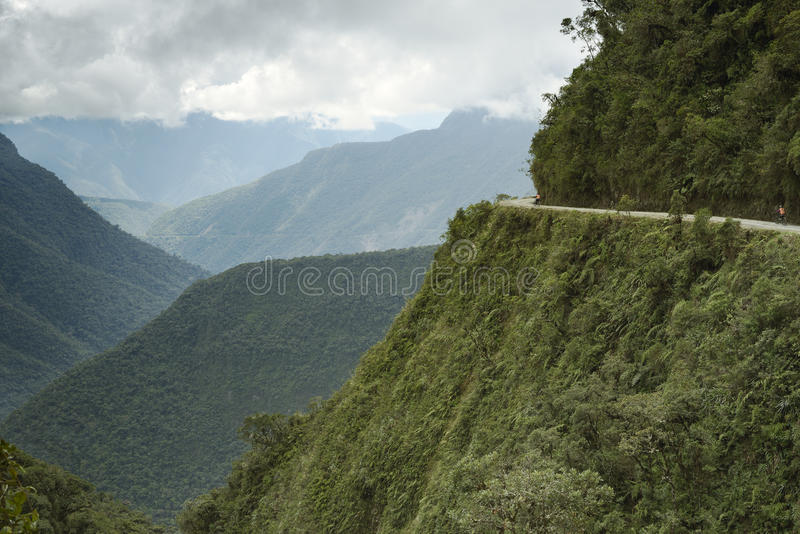 Cyclists riding on the Death Road - the most dangerous road. royalty free stock photos