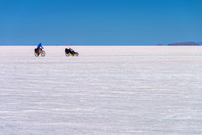 Cyclists in Salar de Uyuni Uyuni salt flats, Potosi Bolivia stock image