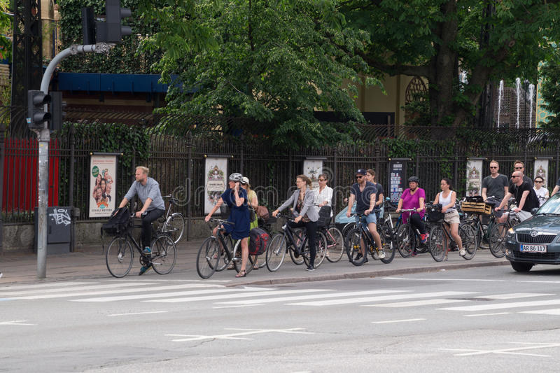 Cyclists waiting for green light, Copenhagen, Denmark. Cycling is an environmentally friendly and healthy way of commuting which is very popular in Copenhagen royalty free stock photo