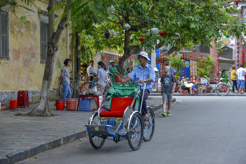 Tuktuk cyclo driver in Hoi An, Vietnam royalty free stock photo