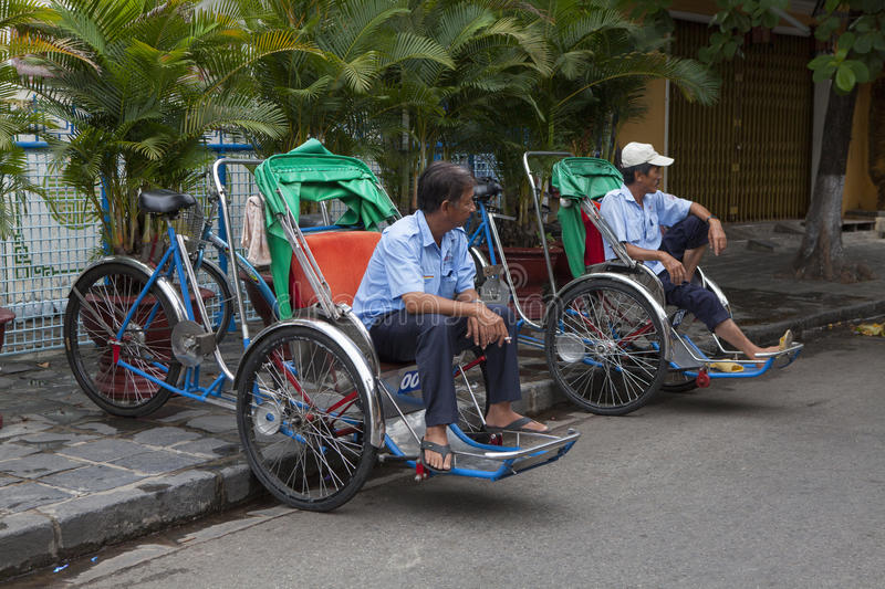 Cyclo drivers waiting for passenger on the side of a street stock photography