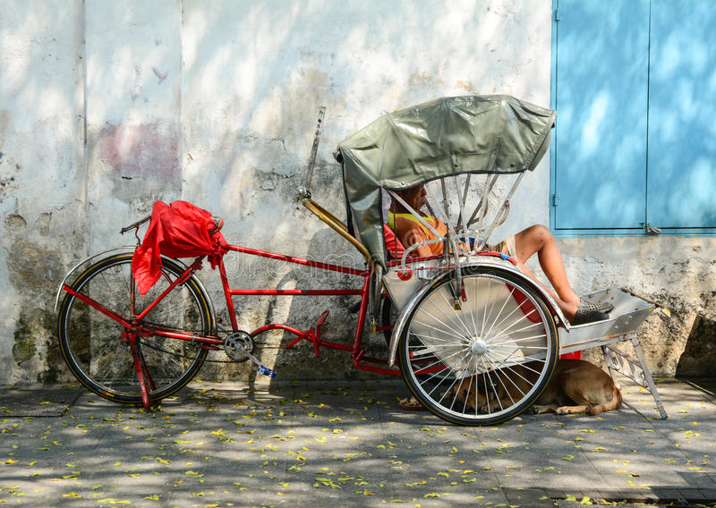 A cyclo on street at Chinatown in Penang, Malaysia royalty free stock photography