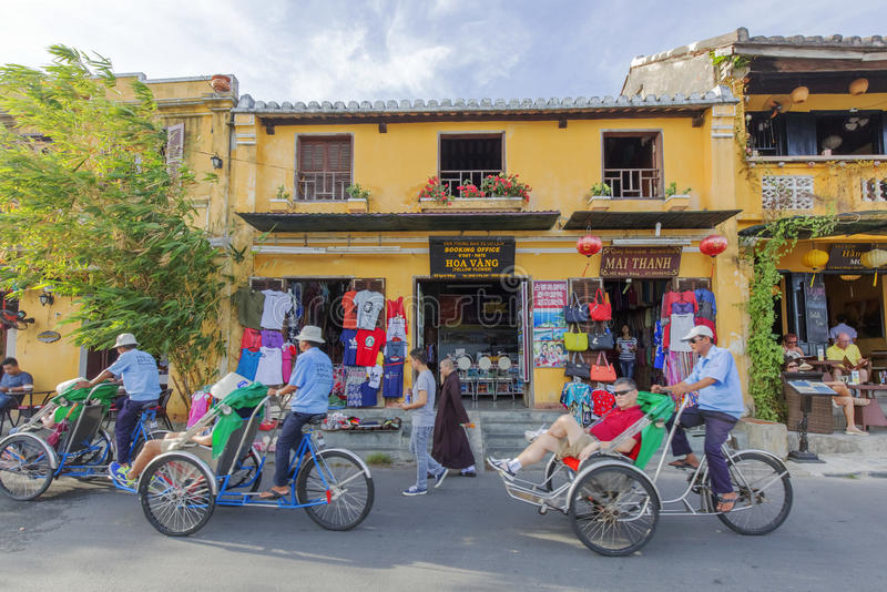 Cyclo on street. In Hoi An, Quang Nam province, Vietnam. Hoi An is a famous tourist destination in the world and Vietnam. Photo taken on: 24 July 2015 royalty free stock images