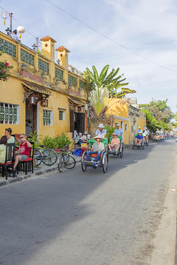 Cyclo on street. In Hoi An, Quang Nam province, Vietnam. Hoi An is a famous tourist destination in the world and Vietnam. Photo taken on: 24 July 2015 stock photo