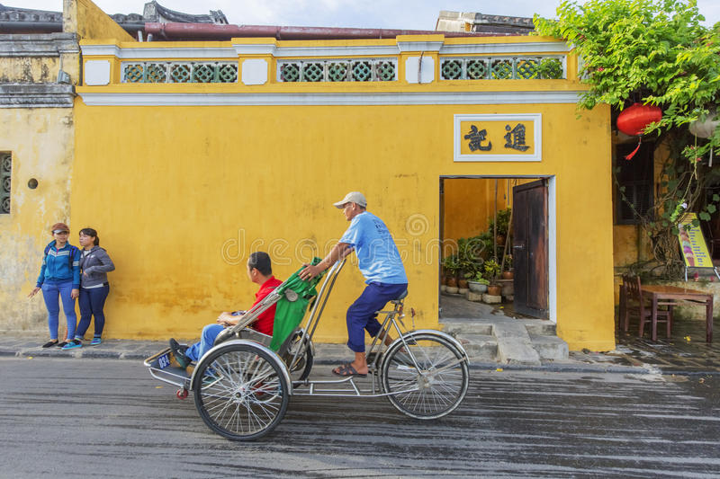 Cyclo on street. In Hoi An, Quang Nam province, Vietnam. Hoi An is a famous tourist destination in the world and Vietnam. Photo taken on: 24 July 2015 royalty free stock photos