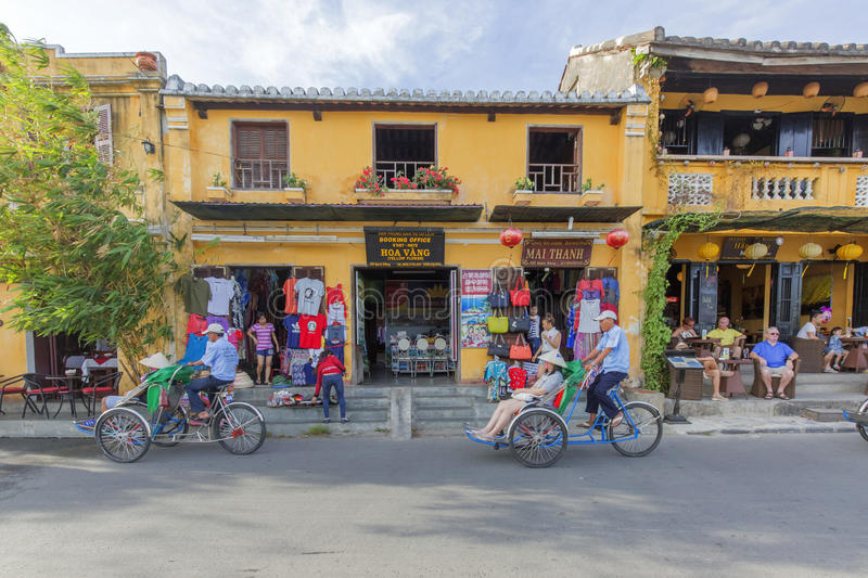 Cyclo on street. In Hoi An, Quang Nam province, Vietnam. Hoi An is a famous tourist destination in the world and Vietnam. Photo taken on: 24 July 2015 royalty free stock photography